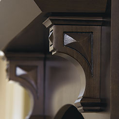 Close-up of decorative corbels in Cherry Kodiak finish