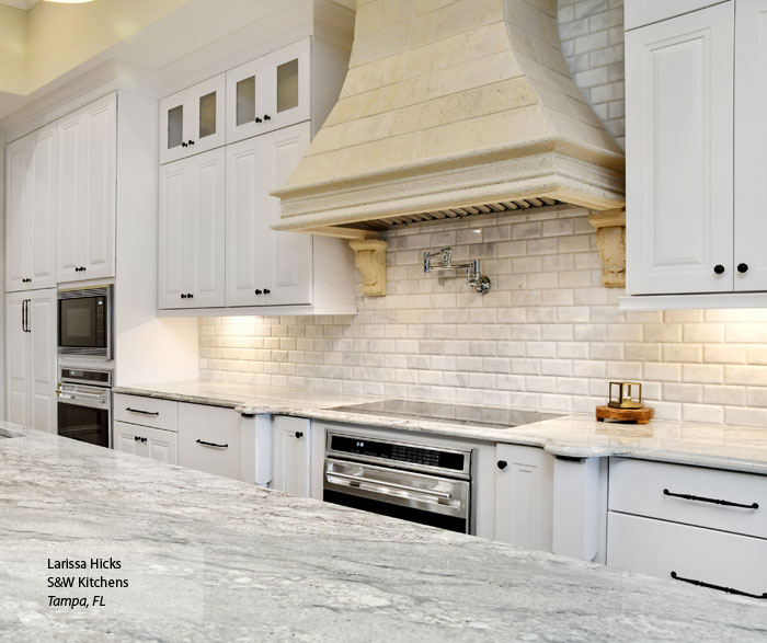 Traditional Kitchen with White Cabinets and a Gray Island