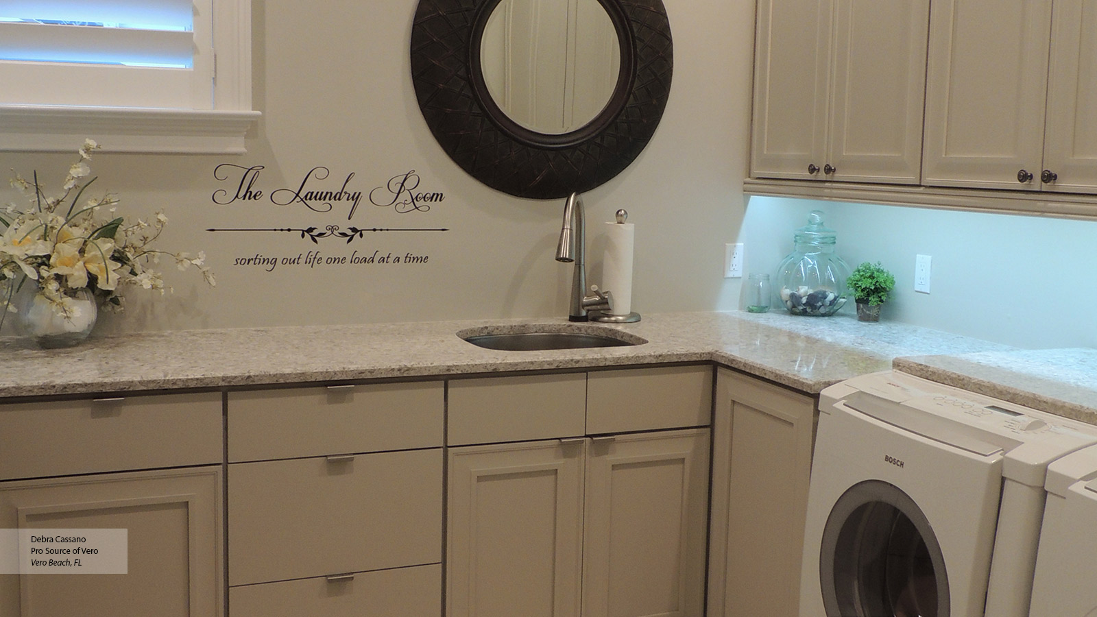 Laundry room storage cabinets omega cabinetry for Cheap laundry room cabinets