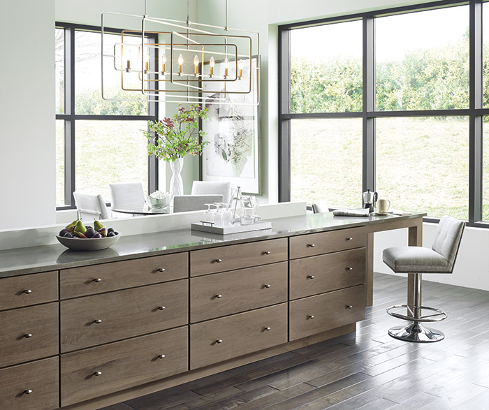 Contemporary kitchen with Cayhill Walnut cabinets in Pumice