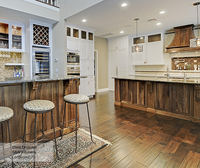 Riff kitchen cabinets in maple pure white with a walnut island in walnut natural