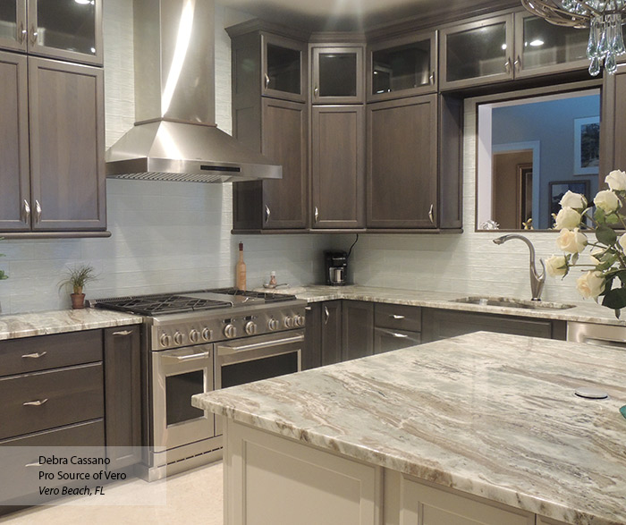 Ultima gray cabinets with an off white kitchen island
